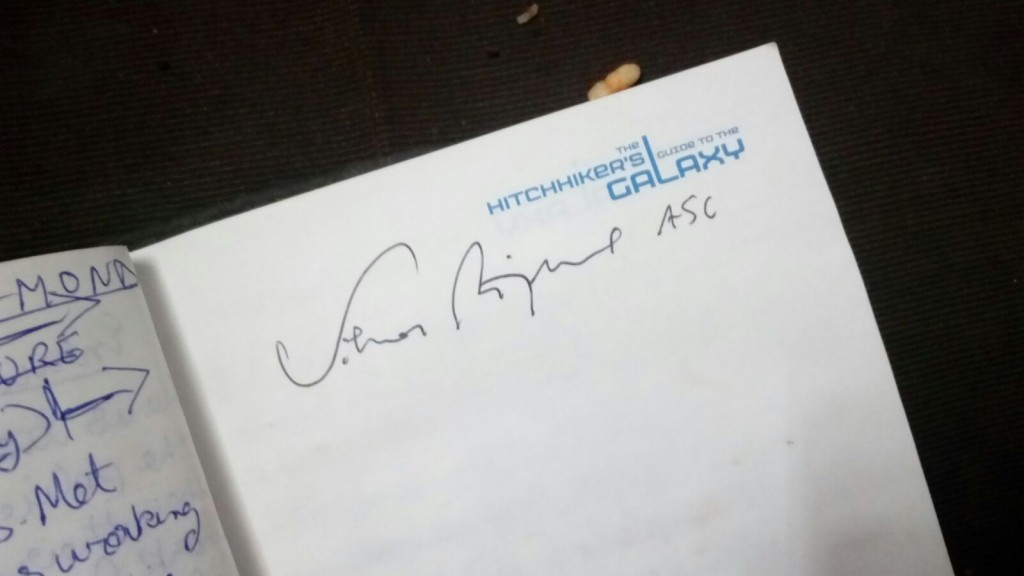 Autograph of Mr. Zsigmond taken on a Hitchhiker's Guide to Galaxy notebook